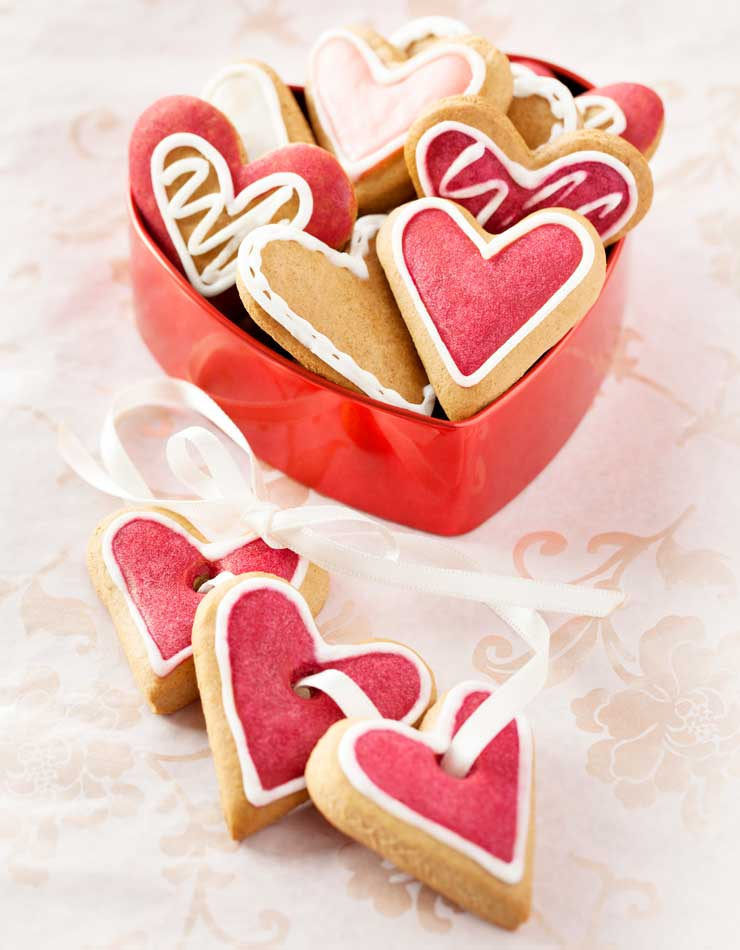 A container of heart biscuits for a wedding