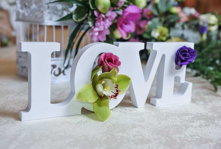 Wedding table letters and flowers
