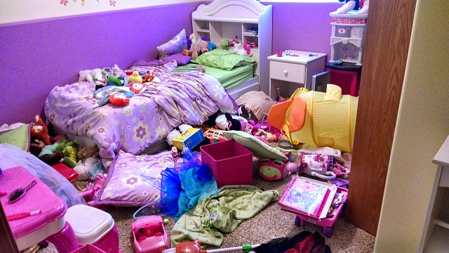 The chaos in this bedroom is the result of a children's birthday party. We're wondering if the little girl is still in there!