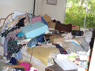 Another incredible mess from Phoenix - this time, in the bedroom. We're really hoping the owner isn't under that pile...