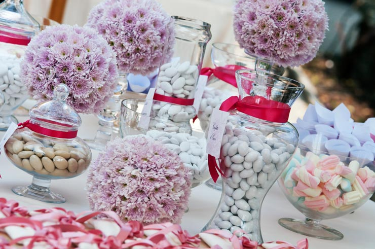 Wedding table with flower balls and sweets