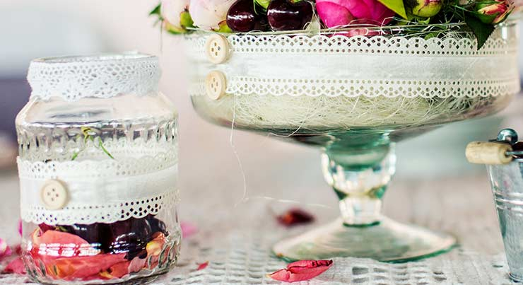 Glass jar with cherries and petals