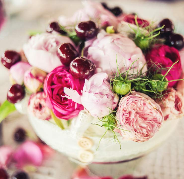 Peonies, roses and cherries in a wedding bowl