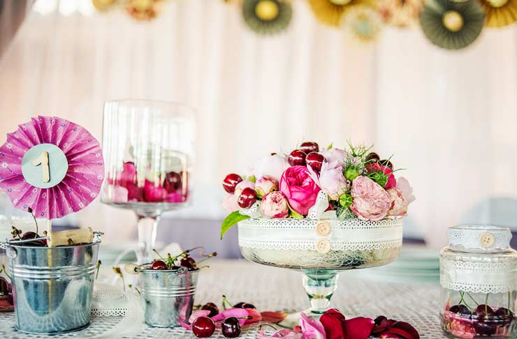 Table arrangement with cherries at a wedding
