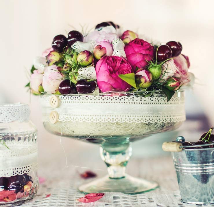 Bowl of flowers and cherries