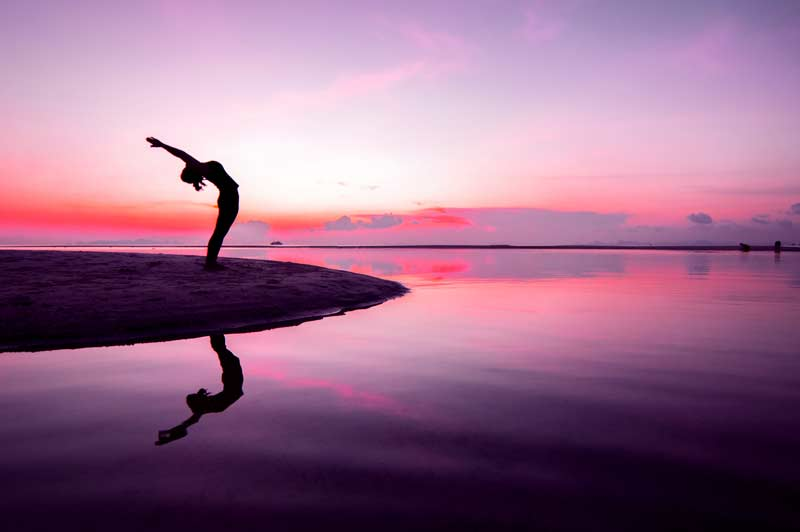 Yoga pose in front of a body of water