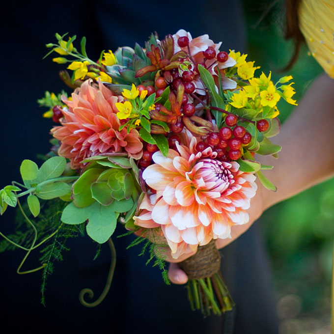 Flowers and berries wedding bouquet