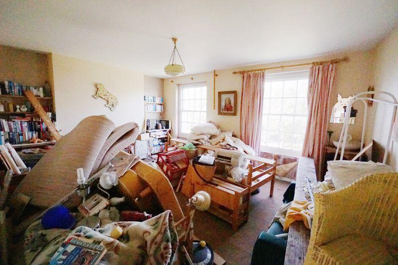 Junk filled house selling for knock down price
